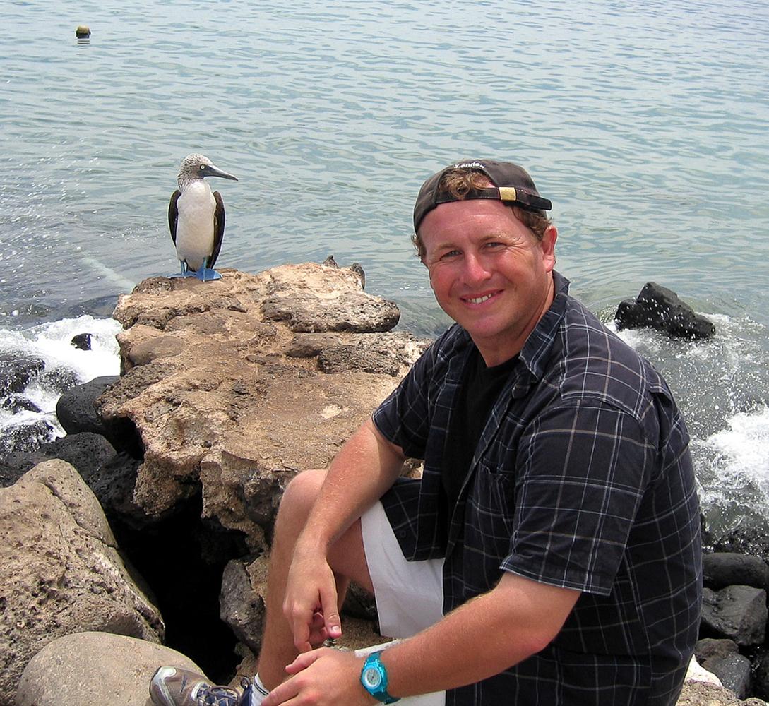 San Cristobal, Galapagos Islands, Ecuador. Bonding with a blue footed Booby!