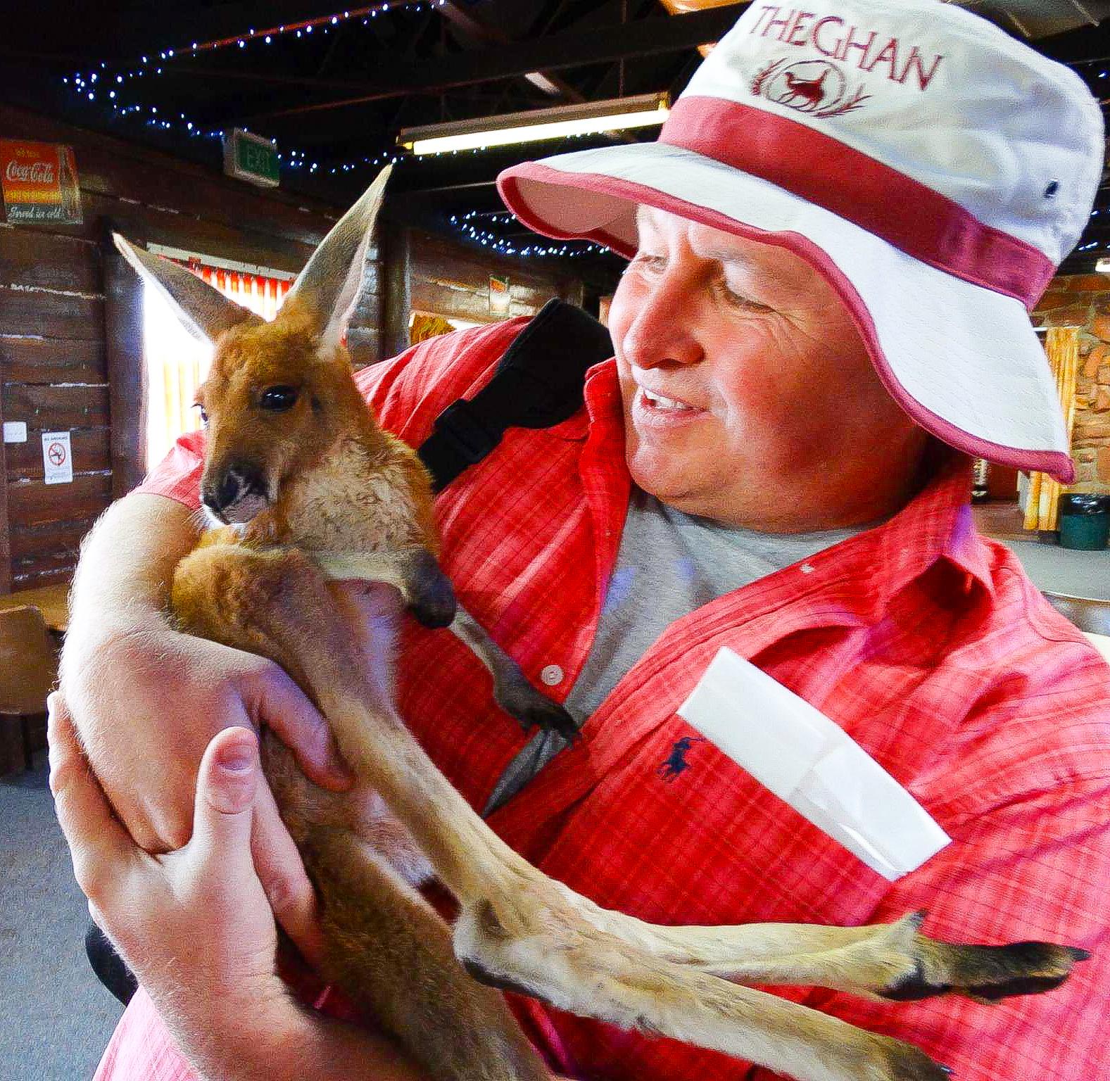 Alice Springs, Australia. Hugging an injured Joey